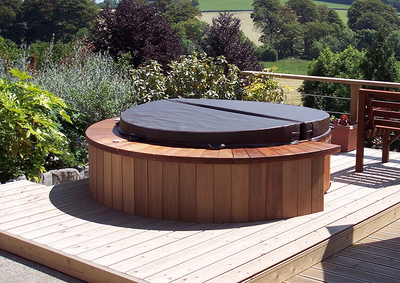 wooden hot tub with dark brown cover